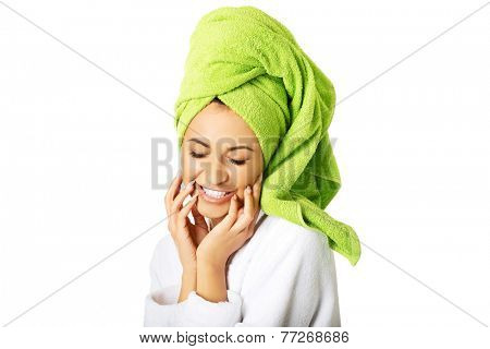 Portrait of a woman wrapped in towel on head.