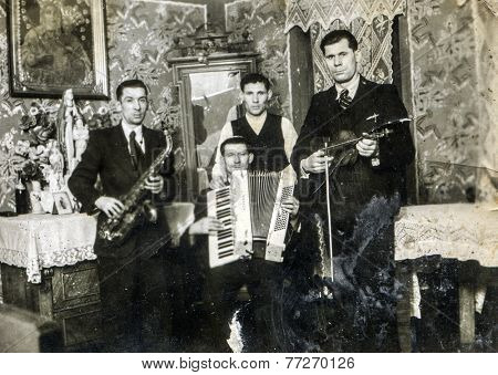 GERMANY, CIRCA 1920s: Vintage photo of group of men with musical instruments