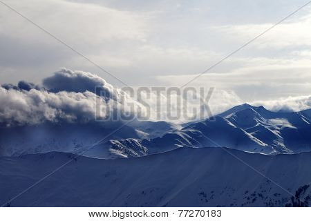 Snowy Mountains In Haze At Sunny Evening