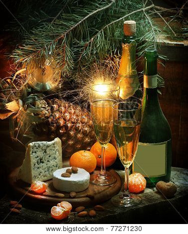 New Year's still-life with champagne, fruit, cheese and a pine branch