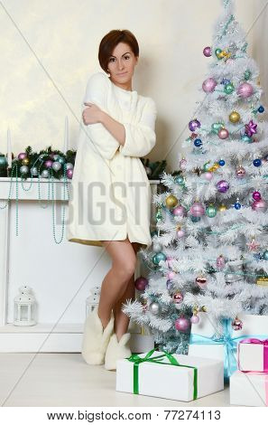 Portrait of  young woman near Christmas tree