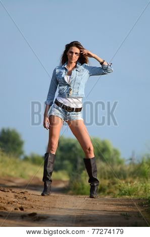 The woman in jeans shorts on road
