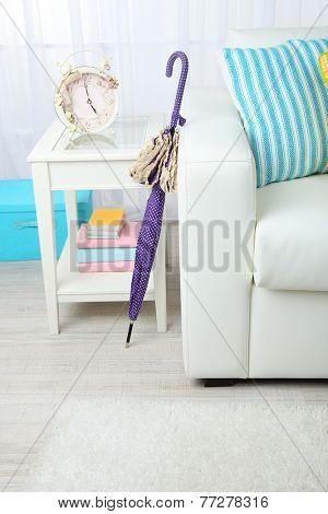Umbrella in home interior close-up