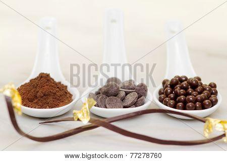 Cocoa Powder, Chocolate Drop And Pralines With Chocolate Garnish