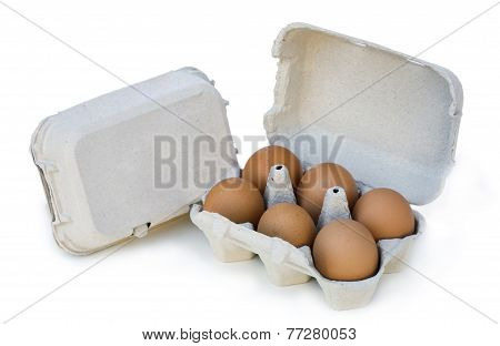 Egg Cup With Six Eggs On White Background