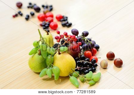 Berries, Fruits, Vegetables And Nuts Mixed On The Table