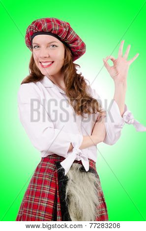 Young woman in traditional scottish clothing