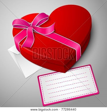 Realistic blank bright red heart shape box with ribbon, envelope and message card.