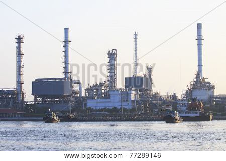 Oil Refinery Plant Beside River In Morning Light