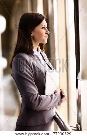 Portrait of businesswoman in modern office building