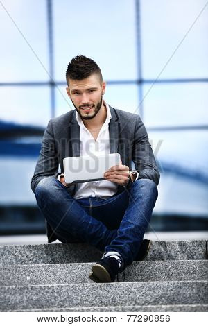 a young business man sitting