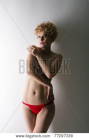 Image of seminude blonde posing at camera