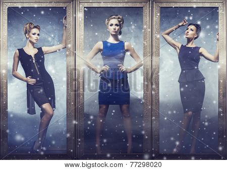 Beautiful women standing in a showcase. Winter shopping and discounts concept.
