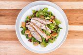 image of caesar salad  - Fresh chicken caesar salad on wooden table - JPG