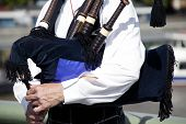 image of bagpiper  - Piper playing traditional Scottish  - JPG