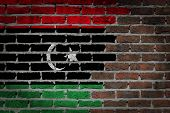 picture of libya  - Very old dark red brick wall texture with flag  - JPG