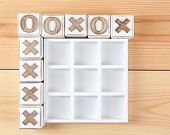 picture of tic-tac-toe  - Game of Tic Tac Toe on wooden background - JPG