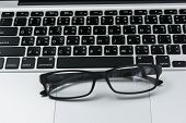 pic of field mouse  - Blank business laptop mouse and glasses on white table  - JPG