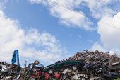 image of junk-yard  - Scrap yard with crushed cars and blue sky - JPG