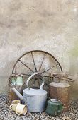 image of wagon wheel  - Rustic scene with wagon wheel watering cans - JPG