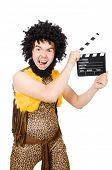 stock photo of hirsutes  - Cave man with movie board isolated on white - JPG