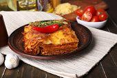 pic of lasagna  - Portion of tasty lasagna on table - JPG
