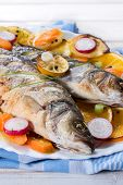pic of bass fish  - Prepared Bass fish with vegetables and fruit in the plate - JPG