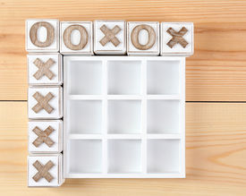 stock photo of tic  - Game of Tic Tac Toe on wooden background - JPG