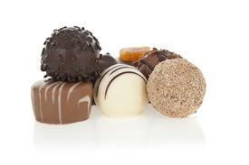 foto of bonbon  - Gourmet chocolate bonbons isolated on white background - JPG