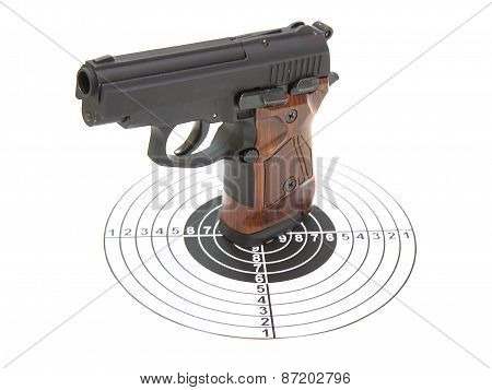The Pistol With The Brown Handle