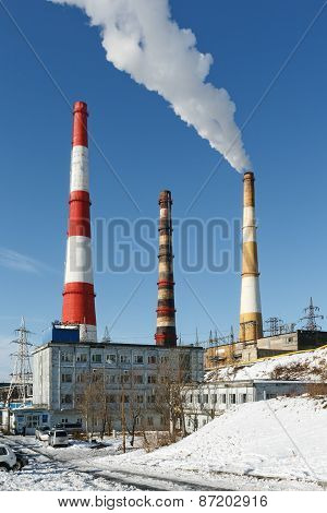 View On Building Kamchatka CHP-1 With Smoking Pipes. Russia, Far East, Petropavlovsk-kamchatsky