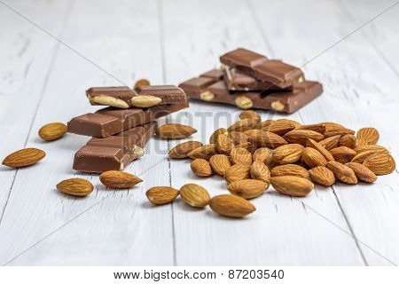Almond And Milk Chocolate On The Wooden Table