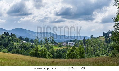Panoramic View Of Landscape With A Farm In The Pyrenees