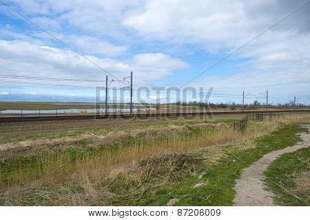 Railroad through the countryside in spring
