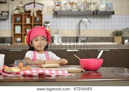 Little Girl Making Dough