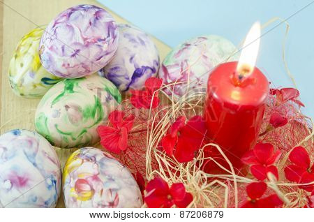 Dozen Of Handcolored Easter Eggs And A Burning Candle