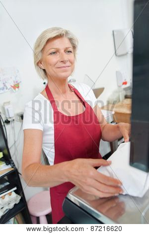 Customer paying at the butcher shop