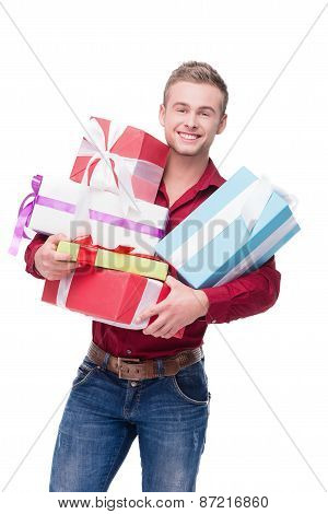 Happy man isolated on white with colourful presents