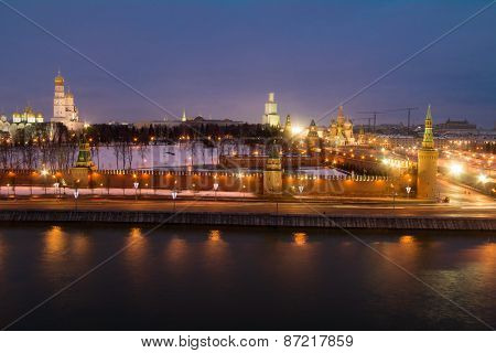Bell tower of Ivan Great, Kremlin wall, Cathedral of St. Basil, Moskva river at evening in Moscow