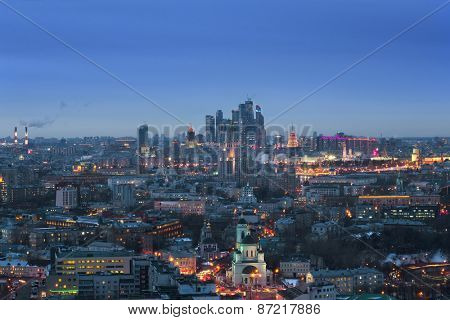 Panoramic view of Moscow City business complex, Stalin skyscrapers, residential buildings and churches at evening in Moscow, Russia