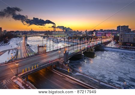 Bridge of Bogdan Khmelnitsky, Borodinsky bridge on Moskva river in winter evening in Moscow, Russia
