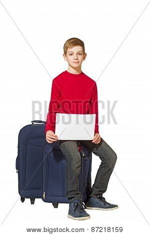 Boy Sitting On Travel Bags Holding Sheet Of Paper Isolated On White