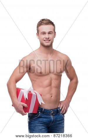Shirtless man holding colourful present isolated on white
