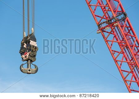 Red Crane Boom With Hook Against Blu Sky