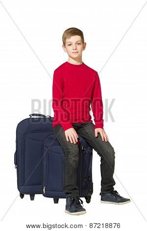 Boy Sitting On Travel Bags Isolated On White