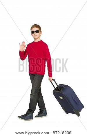 Boy Wearing Sunglasses Walking And Waving Hello With Travel Bags