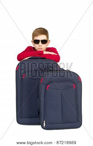 Portrait Of Boy Wearing Sunglasses With Travel Bags