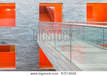 Catwalk Modern Building With Several Floors And Orange Painted Passages
