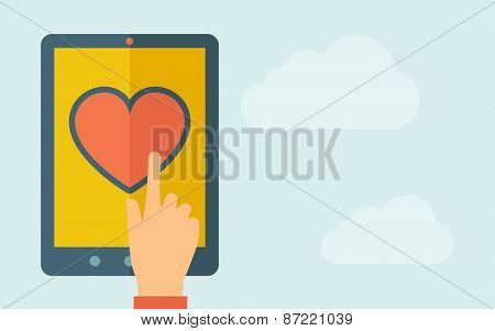 A hand is touching the screen of a tablet with heart icon. A contemporary style with pastel palette, light blue cloudy sky background. Vector flat design illustration. Horizontal layout with text