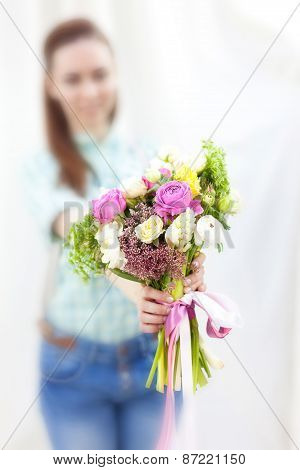 Bunch Of Random Flowers Closeup In Florist's Hands